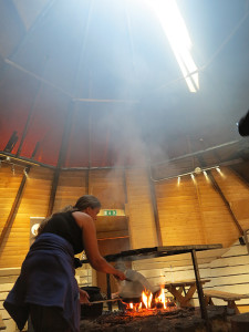 Teresa cooking inside the Sami tent